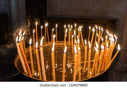 Candles in the Church of the Holy Sepulchre Jerusalem