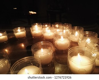 Candles in the church, soft lights.