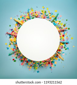 Candles and confetti on blue background,copy space for your text