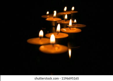 Candles in the dark with soft focus and bokeh. Memorial, hope