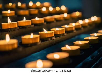 candles of fire shine in christian church as prayer