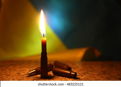 Candles flag colors for remembering day dark background. Pray for Ukraine. Illustrative  Tragedy Russian-Ukrainian war.