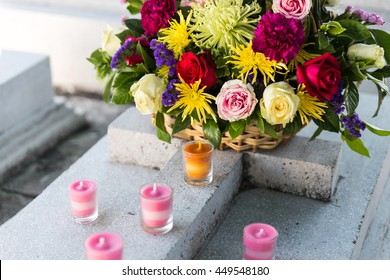 Candles and Flowers over Grave in The Annual Blessing of Graves at Ratchaburi Province, Thailand