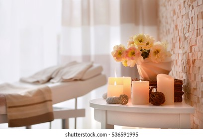 Candles and flowers for relaxation in wellness center