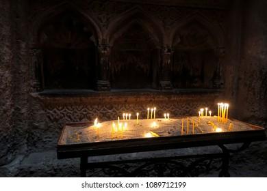 Candles in the Geghard church in Armenia