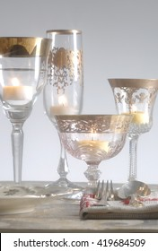 Candles in glass and wooden table