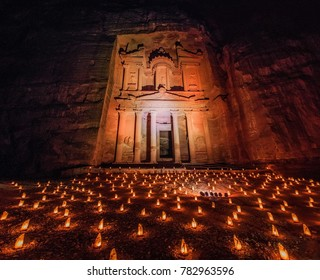 Candles glowing in front of the Al Khazneh temple (The Trasury) in the ancient city Petra, Jordan