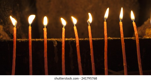 Candles in the Holy Sepulchre in the Jerusalem old city, Israe