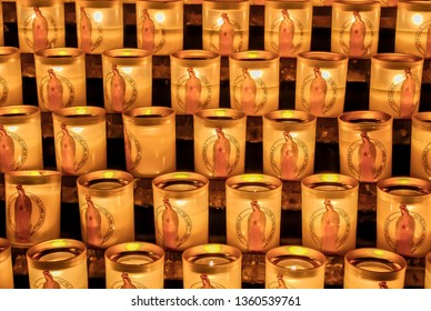 Candles with the image of the saint Maria inside the Notre Dame de Paris famous cathedral located in the old streets in the city center of Paris, France by the Seine river.