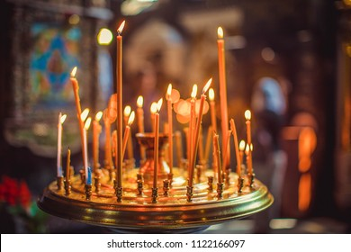 Candles and lamp closeup. Interior of Orthodox Church. Baby christening
