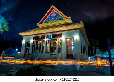 Candles light around temple in Visa kha bucha day with dark night sky background.