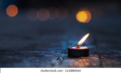 candles light on floor,dark drama tone