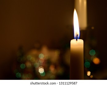 Candles are lighting in the dark room