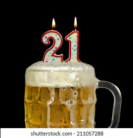 candles in mug of beer for 21st birthday