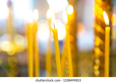 candles from natural wax burn in the church