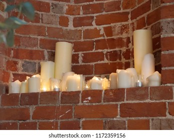 Candles in a nook in a brick wall