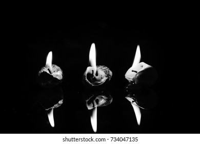 Candles on dark background. Light of candle.