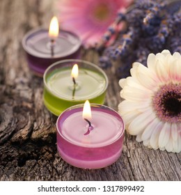 Candles on wooden ground