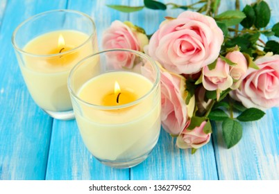 Candles on wooden table close-up
