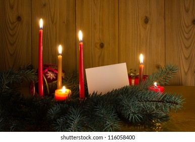 with candles and pine tree branches
