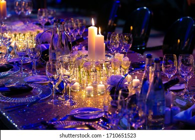 Candles setup on a gala dinner table.