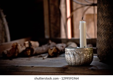 Candles in the silver bowl, wooden floor