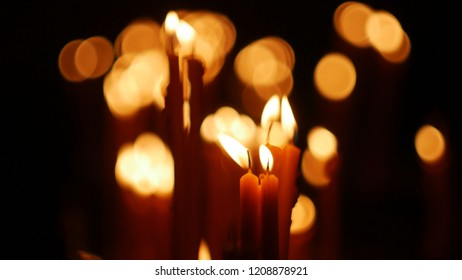 Candles in the temple with a blurred bokeh background