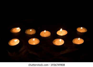 candles that are lit in the dark