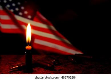 Candles USA flag dark background. Terrorism war.