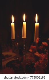 Candlestick with candles on a dark background