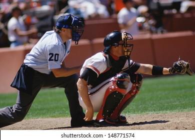 CANDLESTICK PARK, SAN FRANCISCO, CA - CIRCA 1980's: Baseball catcher and umpire at game in Candlestick Park, San Francisco, CA