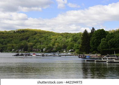 Candlewood Lake on a peaceful summer morning with boats docked and mountainside in background,New Fairfield,Connecticut.