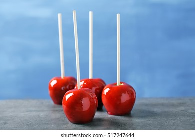 Candy apples on blue blurred background