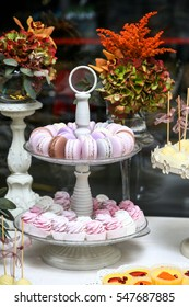Candy bar. Colorful macaroons on a two tier serving tray.