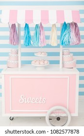 Candy bar. Decor for baby's or child's Birthday party. Dish with marshmallows. Pink, blue and white colors
