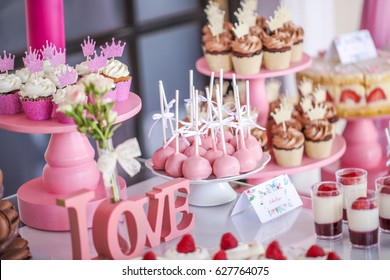 Candy bar with delicious mini cakes, selective focus