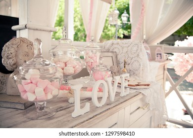 Candy bar. Gingerbread, marshmallows, sweets, decorated with a sweet buffet, the concept of a festive table, buffet. Various sweets for gourmets on the tray for display.