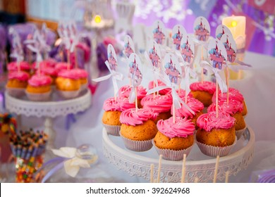 Candy bar for kids birthday party.Sweet holiday buffet with cupcakes and marshmallows and other desserts.