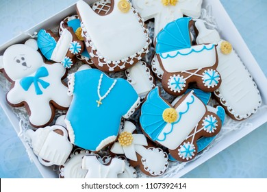 Candy bar on baby's christening party: various gingerbreads with blue mastic
