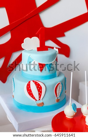 Candy Bar On Boys Birthday Party With A Lot Of Different Candies Popcorn Beverages And Big Cake Decorated In Bluered White Colors