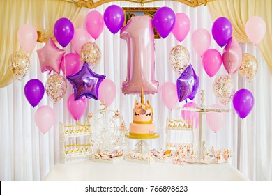 A candy bar in pink and purple tones for a girl who is one year old