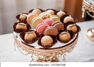 Candy bar with sweet macaroon cakes at a wedding buffet