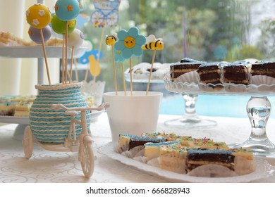 Candy bar table with cake pops and dessert.