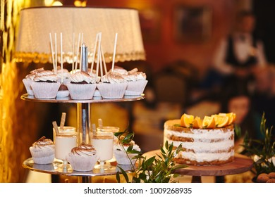Candy bar. Table with sweets - cupcakes, candies, cakes, pies dessert. Wedding candybar