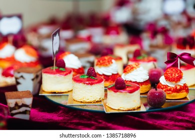 candy bar at the wedding. sweet cupcakes decorated with raspberries