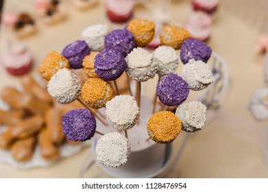 Candy bouquet/Colored fondant cake pops with candy sprinkles close-up in horizontal view from above.