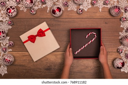 Candy cane as christmas gift inside present box