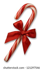 Candy cane with red bow on white background with soft shadow. clipping path included.