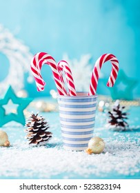 Candy cane sweets in a mug. Christmas and New Year background. Copy space.