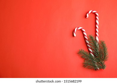Candy canes on red background, flat lay. Space for text